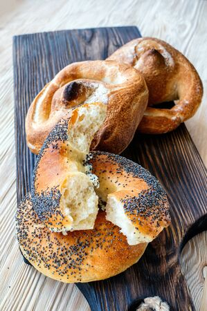 Poppy seed bread with a ruddy crust of homemade baking. Kalach-traditional Russian bread.