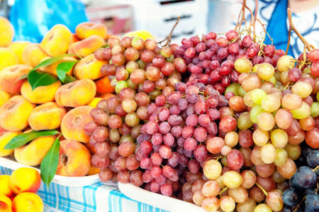 background of various grape varieties at the farmers  market. the harvest of fruits and vegetables is on the counter of the farmers  market