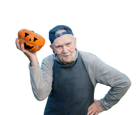 senior gardener with a pumpkin. An old farmer enjoys the pumpkin harvest in the garden. Cheerful active old man holding a pumpkin for Halloween. Isolated on a white background