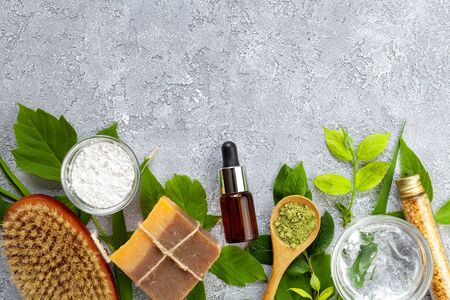 Natural cosmetics with herbal ingredients: soap, alginate mask, serum, sea salt, aloe vera gel on gray background, top view Zdjęcie Seryjne