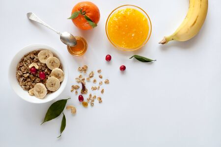 Breakfast with muesli, banana, orange and jam, top view Zdjęcie Seryjne