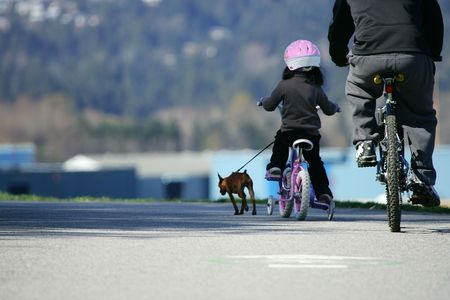stanley: Girl riding bike with her dog, Stanley, park, Vancouver, Canada Stock Photo