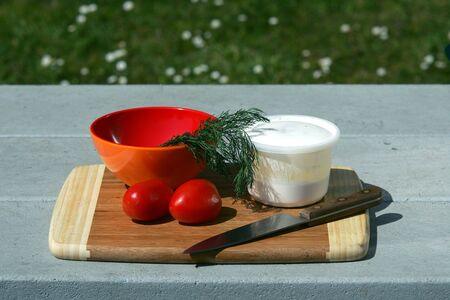 Making salad on picnic table
