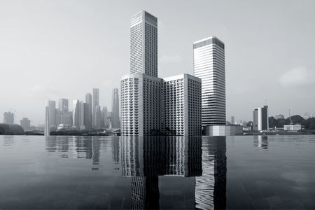 Skyline of modern business district over infinity pool, Singapore