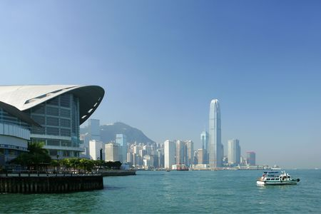Skyline of modern business district and ferry boat, Hong Kong