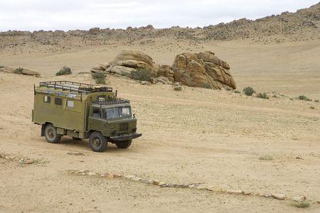 gaz: Old Soviet military truck GAZ-66 in Gobi Desert, Mongolia Stock Photo
