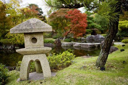 haiku: Stone lantern in Japanese Garden in autumn, Kyoto, Japan