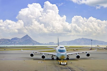 Passenger plane getting ready to take off, Hong Kong photo