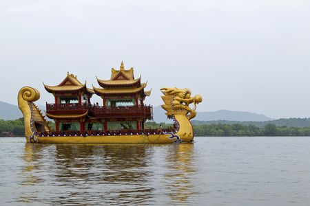 Traditional dragon boat on famous West Lake, Hangzhou, China