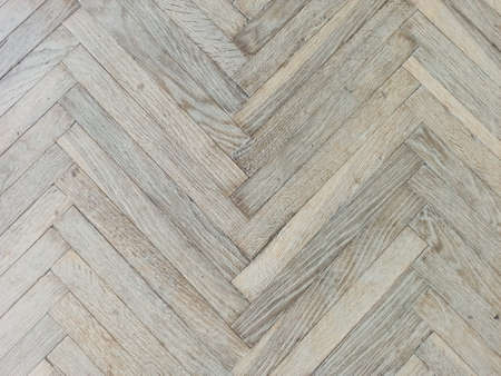Close up texture of old parquet. Wooden flooring in old building. Plank floor surface. Classic light wood block parquet. Stock Photo