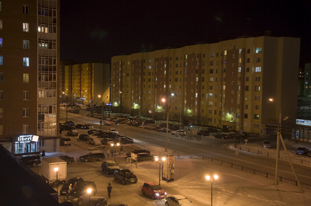 wintriness: View on the night winter city centre. There are road, cars and lights. North