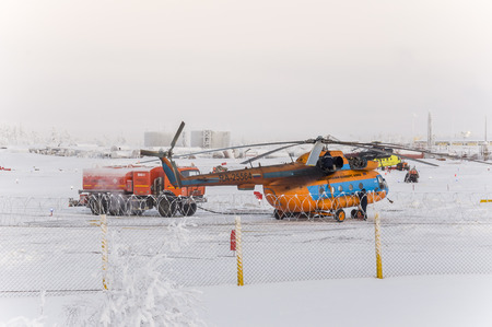 serv: New Urengoy, YaNAO, North of Russia. Helicopter UTair and Konvers avia in the local airport on the service. January 06, 2016