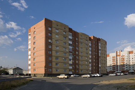 Modern multi-storeyed house with flats. It was built from yellow and orange color