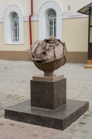 Tomsk, Russia, July 10, 2017. Walking on the city streets in summer. The monument Baby in cabbage. Newborn