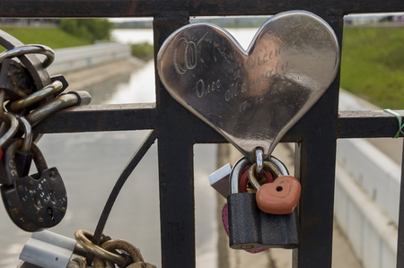 Tomsk, Russia, Lenin street. July 10, 2017. Walking on the city streets in summer. The monument of sincere and pure love. The padlock Editorial