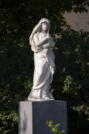 Statue of a beautiful woman in the green park