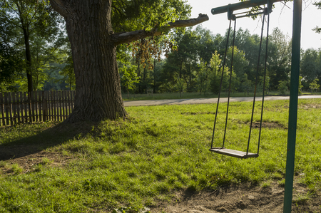 Childrens playground on the yard in summer. Rest with little child. swing in the park Stockfoto