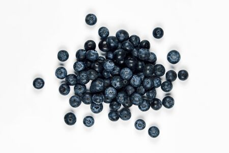 nature and healthy food concept - Top view of fresh blueberries isolated on white background