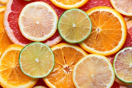 Beautiful fresh sliced mixed citrus fruits like background. Concept of healthy eating, detox, diet. Top view.