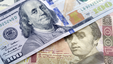 Ukrainian cash hryvnia and dollars USA. Currency exchange rate concept. Dolar is located near the hryvnia at an angle to each other