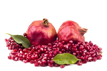 Two whole pomegranate with grains crumble