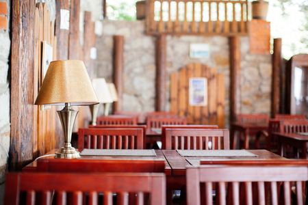 updated: Interior design elements of the restaurant or cafe, tables, wooden chairs, lamps, horizontal image, beautiful blur Stock Photo
