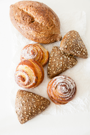 Bakery, bread and sweet buns on a white background with space for your text.