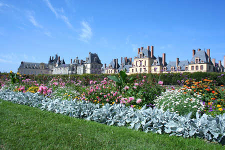 Museum Fontainbleau with flowers on the foreground in France