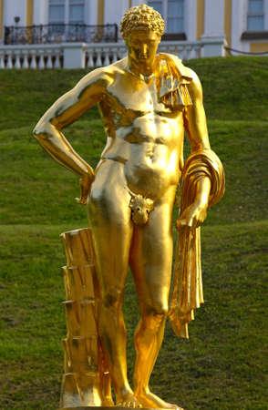 Golden statue of man in Peterhof