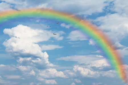 Rainbow and birds in the sky Stock Photo