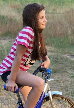 Portrait of a teenager girl on a bike photo