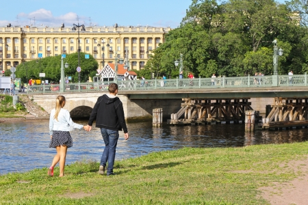 Couple walking along the river photo