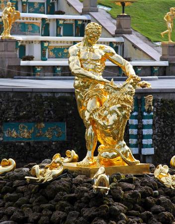 Gold sculpture of Samson in Peterhof Editorial