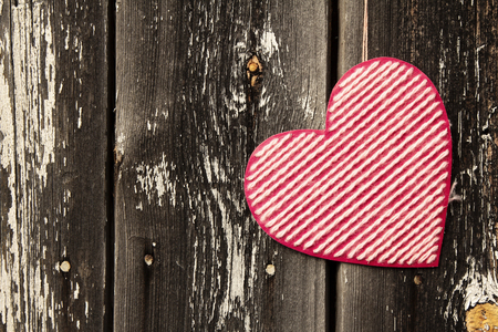 Valentines day background with heart on old wooden background