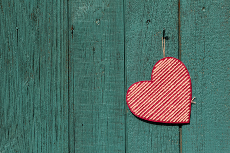 Valentines day background with heart on a wooden background