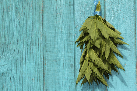 Bunch of nettle on a wooden background