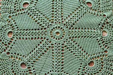 Beautiful closeup crochet doily on wooden background Stock Photo