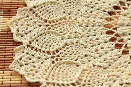 Beautiful crochet doily on wooden background Stock Photo