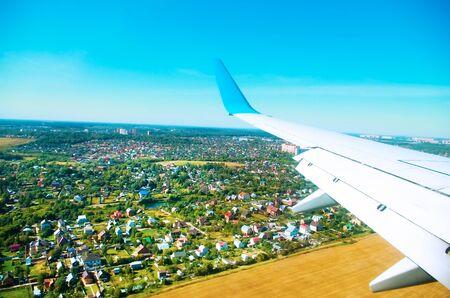 flight mode: flight above a ground in a blue sky Stock Photo