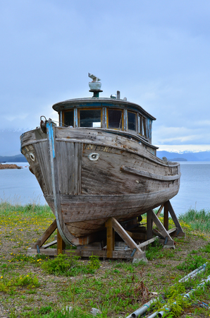 Wooden Old Boat on the coast Stock Photo