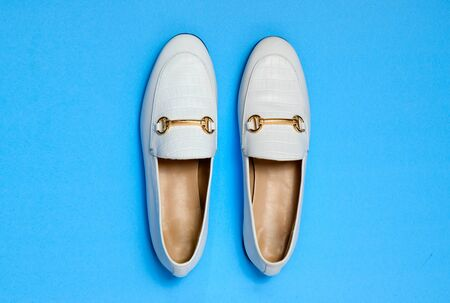 white leather shoes flat lay