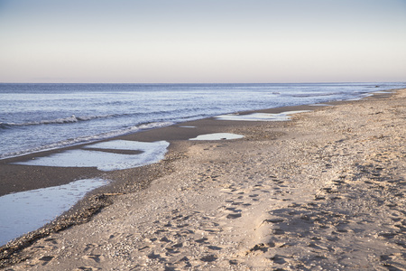The deserted fairy tale beach with golden sand and blue water on the shores of ocean. Stock Photo
