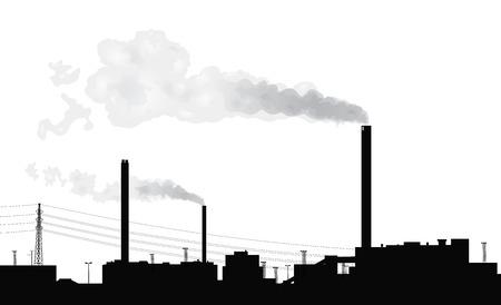Silhouette fabryki z dymu pochodzących z kominów.