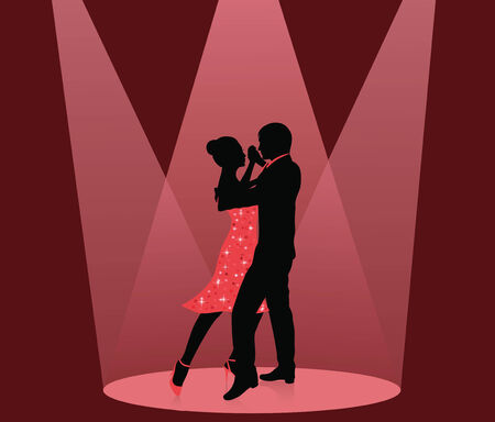Silhouette of a man and a woman dancing in the spot light.