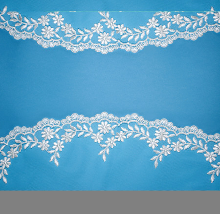Invitation, greeting or wedding card with white lace on blue background. Banco de Imagens - 81208929