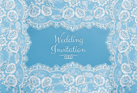 Invitation, greeting or wedding card with white lace on blue background. Banco de Imagens - 80805727