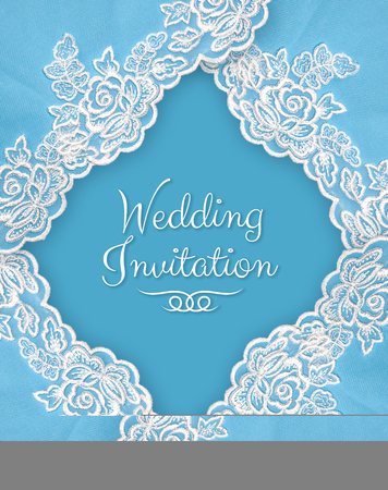 Invitation, greeting or wedding card with white lace on blue background.