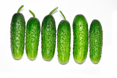 vegetable cook: Cucumbers on white background