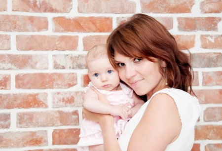 Mother holding sweet baby photo