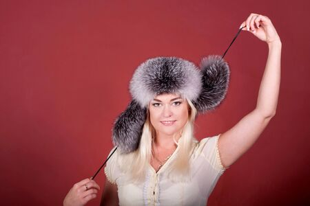 Attractive blond in a fur hat photo